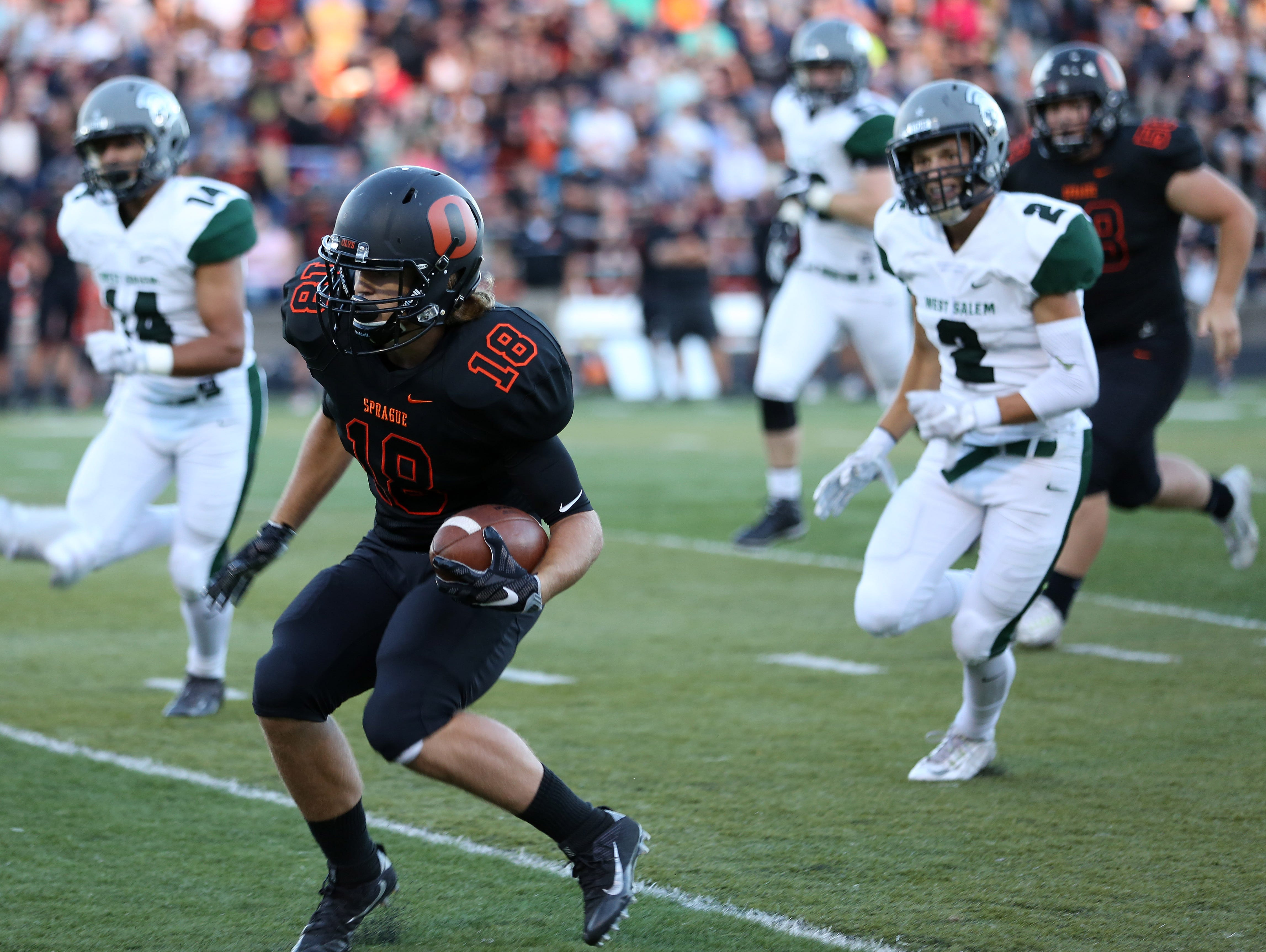 Sprague's Dane McKinney runs the ball as the Olympians fall to West Salem 36-29 in a Greater Valley Conference game on Friday, Sept. 9, 2016, at Sprague High School.