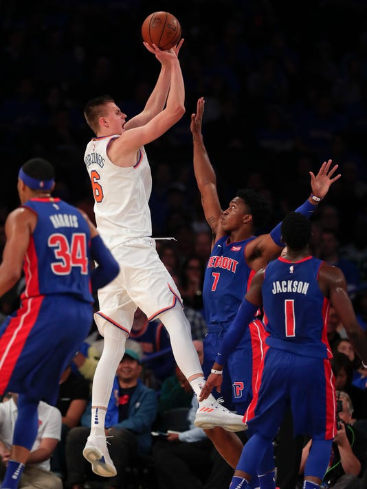 New York Knicks forward Kristaps Porzingis (6) puts up a shot against Detroit Pistons forward Stanley Johnson (7) during the second quarter of an NBA basketball game, Saturday, Oct. 21, 2017, in New York. (AP Photo/Julie Jacobson)