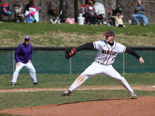 Zack Thompson pitches against Central in a home game