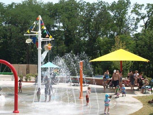 A crowd like this one at the Clippard Park sprayground is manageable, but officials say it gets extreme when a busload of day care youngsters shows up at the splash park.