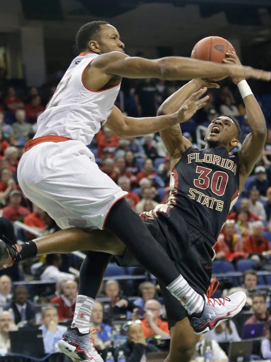 Florida State's Ian Miller (30) shoots over Maryland's Dez Wells (32) during the first half of a second round NCAA college basketball game at the Atlantic Coast Conference tournament in Greensboro, N.C., Thursday, March 13, 2014. (AP Photo/Gerry Broome)
