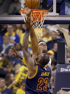 Indiana Pacers center Myles Turner (33) attempts to block the shot by Cleveland Cavaliers forward LeBron James (23) in the first half of their NBA playoff basketball game Sunday, April 23, 2017, afternoon at Bankers Life Fieldhouse.