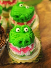 David Molina, owner of Lina Mo Cake Designs created these cupcakes made to look like alligators, a customer''s favorites.