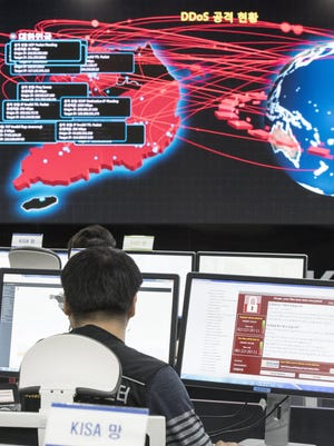 Employees watch an electronic board to monitor possible ransomware cyberattacks at the Korea Internet and Security Agency (KISA) in Seoul, South Korea, 15 May 2017.