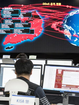 """Employees monitoring possible """"WannaCry"""" ransomware cyberattacks at the Korea Internet and Security Agency (KISA) in Seoul, South Korea."""
