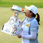 Inbee Park holds the trophy after her five-shot victory in KPMG Women's PGA Championship on Sunday in Harrison, N.Y. HARRISON, NY - JUNE 14:  Inbee Park of South Korea proudly holds the trophy after her 5 shot victory in the final round of the 2015 KPMG Women's PGA Championship on the West Course at Westchester Country Club on June 14, 2015 in Harrison, New York.  (Photo by David Cannon/Getty Images)