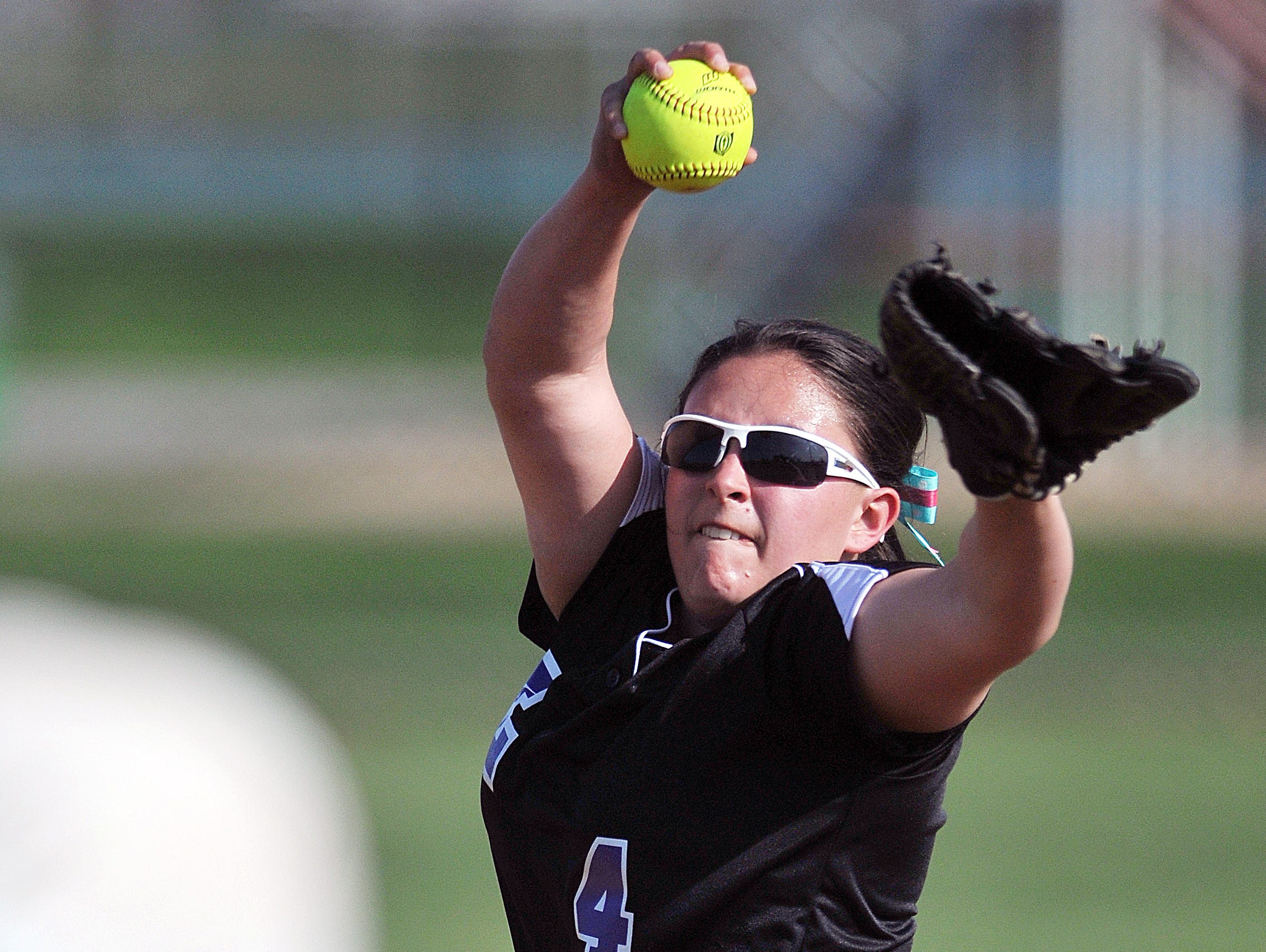 Lexington's Abigail Sgro pitches against Mount St. Dominic during the Wendy's Spring Classic at Brookside Park West Field No. 2 Friday.