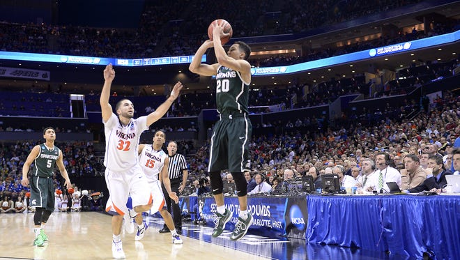 MSU's Travis Trice knocks down one of his four 3-point shots against Virginia during their NCAA tournament game Sunday in Charlotte, N.C.