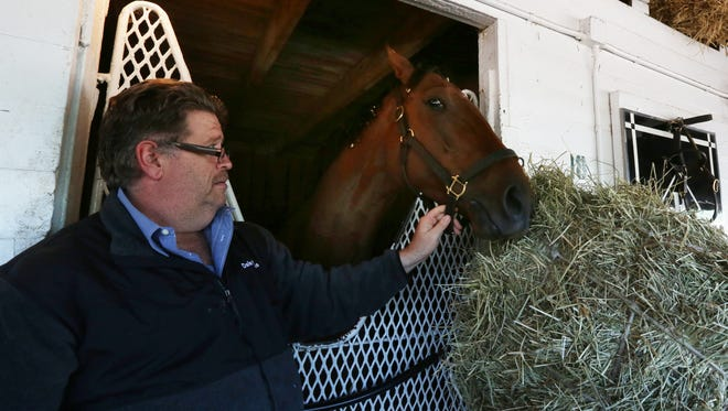 Trainer Dale Romans poses with Keen Ice at Churchill Downs.October 15, 2015
