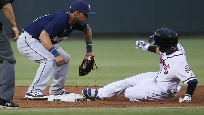 El Paso's Carlos Asuaje slides into second base ahead of the ball and subsequent tag by New Orleans' Robert Andino on Saturday. The play sparked a Chihuahuas' rally.