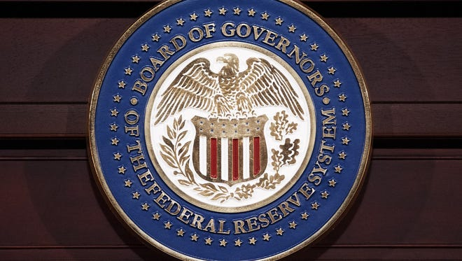 File photo taken in 2013  shows the seal of the Federal Reserve Board of Governors in Washington, D.C.