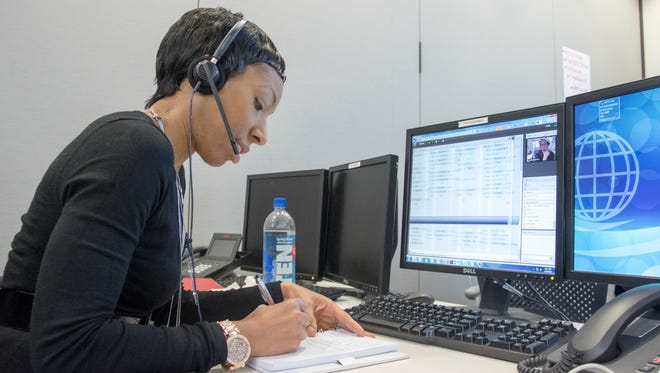 Allison Cooke-Washington conducts a teleconference as she participates in the new IT program at Navy Federal Credit Union in Pensacola on Friday, January 27, 2017.