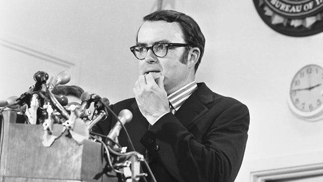 """FILE - In this May 15, 1973 file photo, then-acting FBI director William Ruckelshaus pauses during a news conference in Washington. President Donald Trump's surprise firing of FBI Director James Comey drew swift comparisons to the Nixon-era """"Saturday night massacre."""" Both cases involve a president getting rid of an official leading an investigation that could ensnare the White House, said Douglas Brinkley, a presidential historian at Rice University.(AP Photo/Charles Gorry)"""