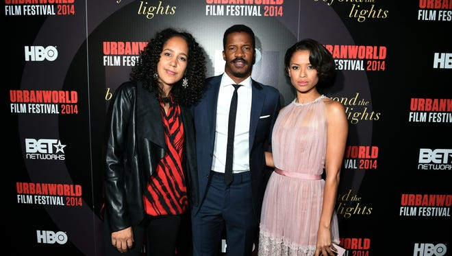 NEW YORK, NY - SEPTEMBER 18:  (L-R)  Writer/director Gina Prince-Bythewood, actors Nate Parker and Gugu Mbatha-Raw attend BEYOND THE LIGHTS opening The Urbanworld Film Festival at SVA Theater on September 18, 2014 in New York City.  (Photo by Dimitrios Kambouris/Getty Images for Relativity Media)