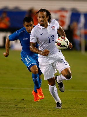 U.S. midfielder Jermaine Jones (13)  dribbles the ball as  Honduras forward  Roger Rojas (21) chases the first half at FAU Stadium on Tuesday.