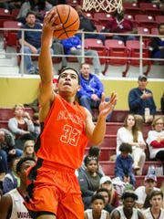 Blackman's Trent Gibson goes up for a layup during