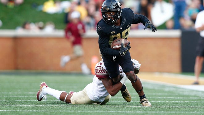 Wake Forest wide receiver Greg Dortch is tackled by Florida State defensive back Kyle Meyers.