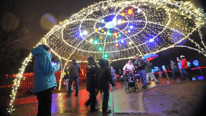 Despite the rain Dec. 22, 2015, visitors tour around the many Christmas lights and Nativity scenes at the Rotary Winter Wonderland in Marshfield. Wausau set a record Monday for the amount of rainfall on Dec. 4.