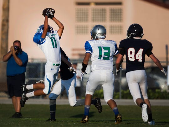 Bonita Springs High School running back, Francisco Garcia makes an interception during the first half of their first-ever football game against Estero on Wednesday, September 27, 2017 at Estero High School.