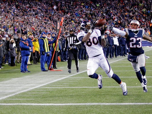 Denver Broncos tight end Julius Thomas (80) catches a touchdown pass in front of New England Patriots strong safety Patrick Chung (23) in the second half of an NFL football game on Sunday, Nov. 2, 2014, in Foxborough, Mass. (AP Photo/Stephan Savoia)