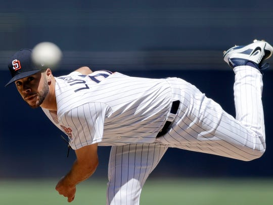 San Diego Padres starting pitcher Joey Lucchesi works against a Seattle Mariners batter during the first inning of a baseball game Wednesday, Aug. 29, 2018, in San Diego. (AP Photo/Gregory Bull)