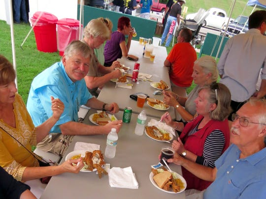 Diners at the 36th annual Newburgh Fiddler Fest enjoy fresh fried fish dinners under the tent on a hot August evening. Catfish wasn't the only food available at the fest, but of course it was the star of the show.