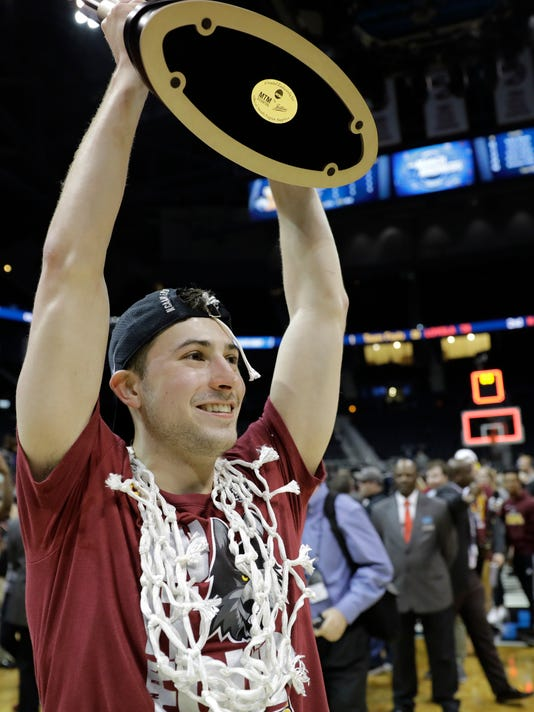 Game MVP, Loyola-Chicago guard Ben Richardson holds a trophy after a regional final NCAA college basketball tournament game against Kansas State, Saturday, March 24, 2018, in Atlanta. Loyola-Chicago won 78-62. (AP Photo/David Goldman)