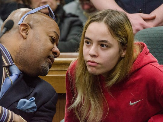 Defendent Amber Marie Tackett speaks with attorney