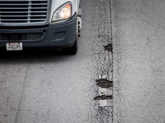 Potholes like these on Interstate 69 last winter damaged numerous vehicles whose owners' damage claims have been denied.