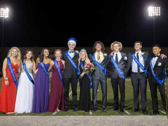 Homecoming King Anthony Gavazzi and Queen Cadie Kiser, center, stand between the other members of Chambersburg Area Senior High School's homecoming court on Friday, September 23, 2016.