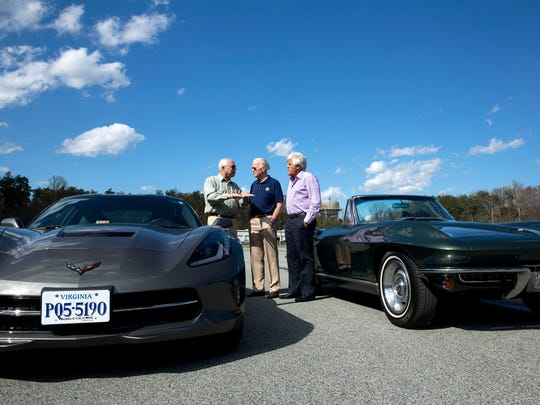 """Vice President Joe Biden (center) speaks with Colin Powell (left) and Jay Leno and  next to his restored 1967 Corvette while taping a segment for """"Jay Leno's Garage,"""" which debuts Wednesday."""