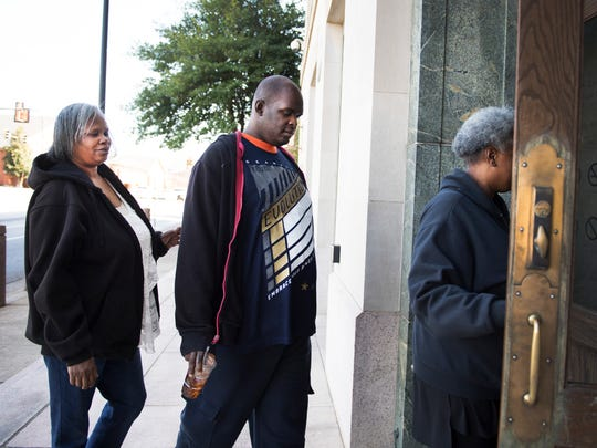 Tario Anderson enters the courthouse with family members on Wednesday, February 8, 2017.