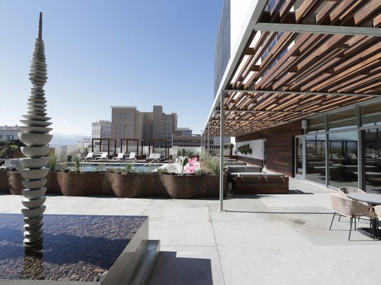 Artwork, pergolas and fountains are part of the fifth-story pool area at Hotel Indigo in Downtown El Paso.