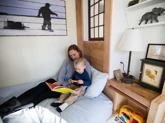 Jenny Mikkelson reads to her son Matthew in his tiny bedroom at his grandparents' home.