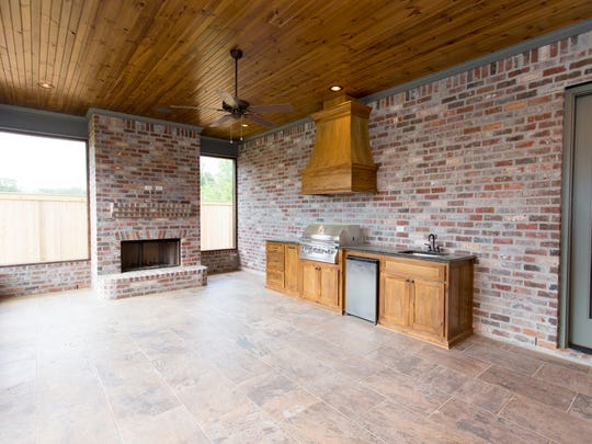 The outside boasts a fireplace with a full kitchen