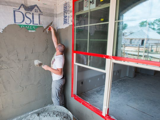 Andrei Cosohari, of Stucco Design, works on one of