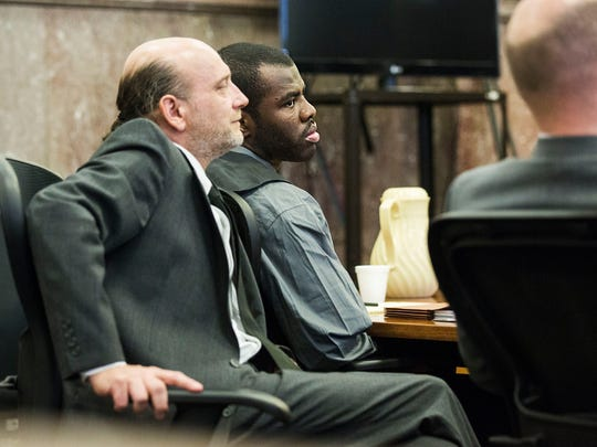 Lamar Wilson, 24 of Iowa City, and his attorney's John Bruzek and Matt Shimanovsky listen to opening statements on Thursday, Jan. 25, 2018, during Wilson's trial where he faces multiple charges from a shooting on Iowa City's pedestrian mall in Aug. 2017, in the Polk County Courthouse in Des Moines.