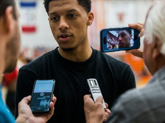 Iowa State's Lindell Wigginton talks to reporters during