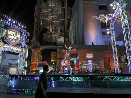 """A contestant competes on """"American Ninja Warrior"""" in Philadelphia last month. Wilmington's D'Angelo Lewis-Harris will appear on the program Monday night on NBC."""