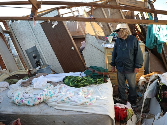 Michael Nelson stands in what was his bedroom after his home was desetroyed by Hurricane Michael when it passed through the area on Oct. 13, 2018 in Panama City, Florida. The hurricane hit the Florida Panhandle as a category 4 storm causing massive damage.