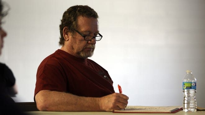 Mark Stodgell, a West Lafayette Jr./Sr. High School counselor, takes notes Tuesday, May 19, during a forum on Tippecanoe County youth and gang activity at the Bauer Family Resources community center, 330 Fountain St. in Lafayette.