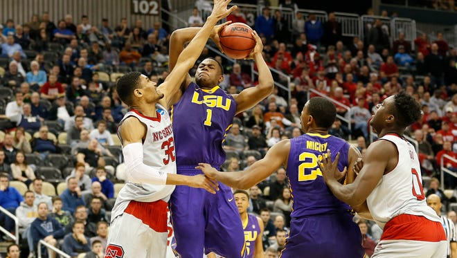LSU Tigers forward Jarell Martin (1) shoots the ball as North Carolina State Wolfpack forward Kyle Washington (32) defends in the second round of the 2015 NCAA Tournament.