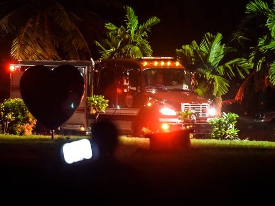 A Guam Fire Department rescue unit can be seen at the Fort Nuestra Señora de la Soledåd, or Fort Soledad, as rescue efforts are underway for three distressed surfers just outside the mouth of Umatac Bay on Friday, Oct. 20, 2017.