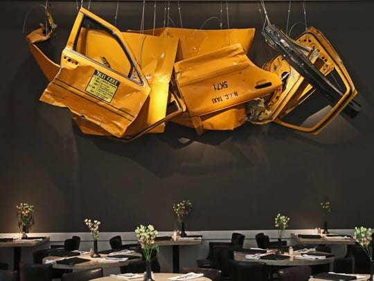 Pieces of an old New York City cab hang from the ceiling at Elsa's on the Park as part of the 5000 Rides artwork exhibit.