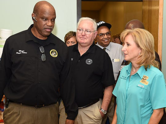 Mayor Reggie Tatum and St. Landry Parish President Bill Fontenot escort Louisiana's First Lady Donna Edwards into the Opelousas Civic Center Friday morning where a shelter was set up to house victims of the recent flooding.