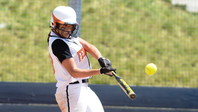 Fernley High School's Kelsie Callahan takes a big cut at a pitching against Fallon during the May 24 State Championship Softball game.