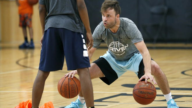 Former McQuaid basketball star Tyler Relph demonstrates a dribbling drill during a clinic at his alma mater. He has become an elite basketball trainer, with some clients who are in the NBA.