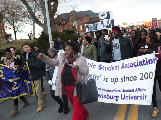 Diane Jefferson, center,  Director Multicultural Student Affairs at Shippensburg University leads the crowd with chants during the Dr. Martin Luther King Jr. March for Humanity at Shippensburg University on Thursday, Feb. 2, 2017.