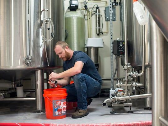 Josh Deitner, the Head Brewmaster at Bone Hook Brewing,
