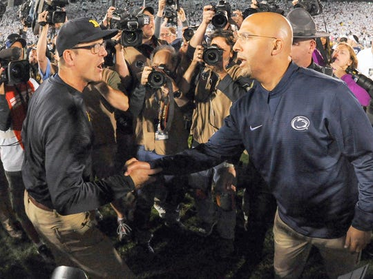 Michigan head coach Jim Harbaugh and Penn State head coach James Franklin shake hands following the game on Saturday, October 21, 2017 at Beaver Stadium in University Park, Pa.